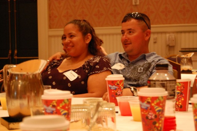 Sgt. Carlos Ariasochoa, Company F, 1st Battalion, 15th Infantry Regiment, 3rd Heavy Brigade Combat Team, 3rd Infantry Division, and his wife, Miriam, listen to a class during 1-15 Infantry Regt.'s recent marriage retreat to Orlando, Fla. May 8-10.