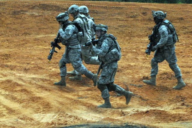 Soldiers assigned to Troop C, 3rd Squadron, 1st Cavalry Regiment, 3rd Heavy Brigade Combat Team, 3rd Infantry Division, move out during a training exercise at Cactus Range on Fort Benning, Ga., May 15. The exercise was part of Hammer Focus, the 3rd HBCT's largest field training exercise, and employed native Arabic speakers to get the Soldiers used to what they may experience while deployed overseas.