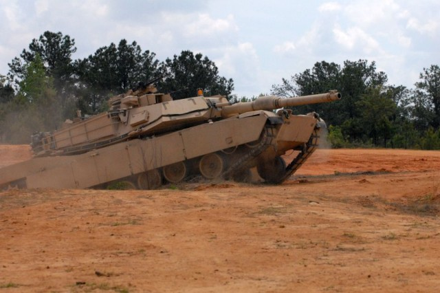 A tank assigned to Company D, 1st Battalion, 15th Infantry Regiment, 3rd Heavy Brigade Combat Team, 3rd Infantry Division, gets into position during a training exercise at Cactus Range on Fort Benning, Ga., May 15. The exercise, part of Hammer Focus, the 3rd HBCT's largest field training exercise, helped Soldiers assigned to Company D perfect their battle drills and practice their new tactics, techniques and procedures.