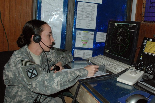 Sgt. Sarah Hotchkiss operates the Air Traffic Navigation Integration Control System radar April 16 from the tower on Contingency Operating Base Speicher. Originally intended to recover aircraft caught flying bad in weather, Fox Company has expanded the role of ATNAVICS to become a radar-approach facility.