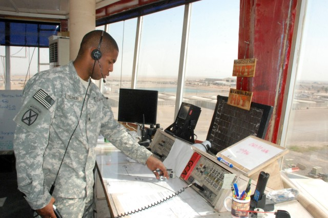 Sgt. Dannie Oliver, Fox Company, 3-10 General Support Aviation Battalion, controls arrivals and departures to the airfield April 16 from the air-traffic control tower on Contingency Operating Base Speicher.