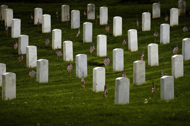 Flags stand vigil at gravesites in Arlington National Cemetary. The 3rd U.S. Infantry Regiment (The Old Guard) began their rounds to place a small American flag into the ground in front of every grave marker at Arlington National Cemetery for the upcoming Memorial Day observance.