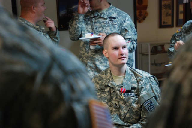 Philippi, W. Va. native, Sgt. John Hoxie, Co. C, 1st Battalion, 325th Airborne Infantry Regiment, 2nd Brigade Combat Team, 82nd Airborne Division, at a reception following an award ceremony May 19. Hoxie received the Bronze Star medal at the ceremony for his heroism while on a 2007 deployment to Iraq.
