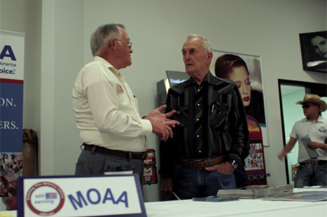 Retired Air Force Maj. Frank Duckett, Military Officers Association of America Virginia Peninsula Chapter legislative chair, speaks with retired Warrant Officer Tom Gentry about MOAA. About 40 organizations, including Disabled American Veterans, Military Order of the Purple Heart and the American Association of Retired Persons, had displays in the Post Exchange for the Fort Eustis Retiree Appreciation Day. About 140 retirees came out for the event.
