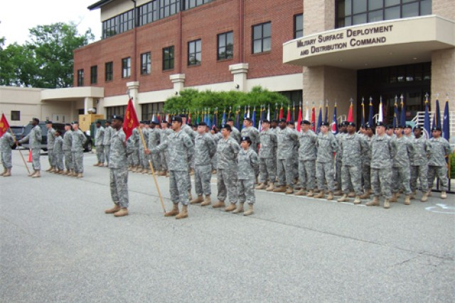 The 688th and 689th Rapid Port Opening Elements stand in front of the Military Surface Deployment and Distribution Command headquarters, Bldg. 661 at Fort Eustis during a patch changing ceremony Friday. The ceremony signified the transfer of authority of the 688th and 689th RPOEs from the 7th Sustainment Brigade to the 597th Transportation Terminal Group.