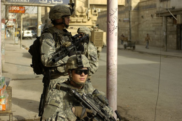 Soldiers with 2nd Platoon, B Company, 3rd Battalion, 8th Cavalry Regiment provide rear security as teams of Iraqi National Police and their fellow Bulldog Soldiers clear buildings throughout Old Town, a neighborhood in west Mosul on April 23.
