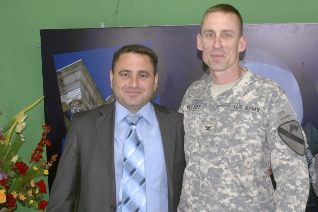 Col. Gary Volesky, commander, 3rd Bde, 1st Cav. Div., and a news anchor pose for a picture after recording an interview that aired May 17 on Al Mosulia, a local Mosul news agency station. Volesky discussed key security topics and concerns in Ninewa province.