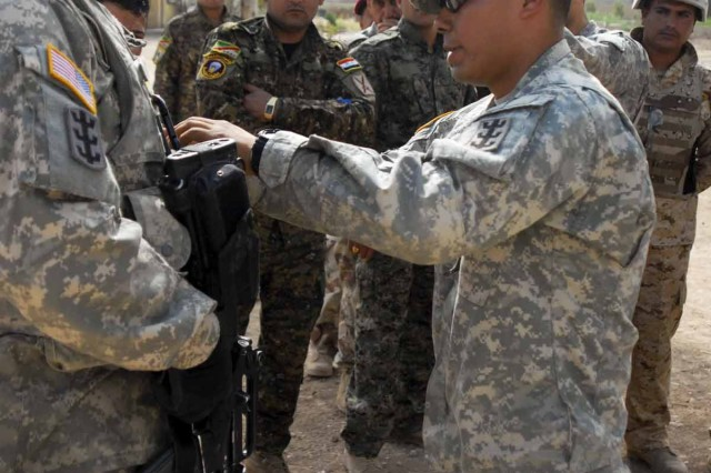 Sgt. Glen Rivera, a non-commissioned officer with Headquarters Pltn., Headquarters and Headquarters Co., 84th Engineer Bn., 18th Engineer Bde., 25th Inf. Div. demonstrates how to perform a pre-command check as part of the 2nd Iraqi Army Div. Eng. Regt. Non-Commissioned Officer Academy. This is the second course of its kind at Al Kindi in east Mosul, the site of the division's headquarters. Rivera and other NCOs with Headquarters Pltn. were instructors for the four-day curriculum which was completed May 16.