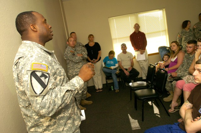Maj. Hugh Charles-Walters, rear detachment commander of 4th Brigade Combat Team, 1st Cavalry Division, speaks to Liberty Village Housing Area residents about the third quarter town hall meeting's agenda May 18, at Fort Hood, Texas.