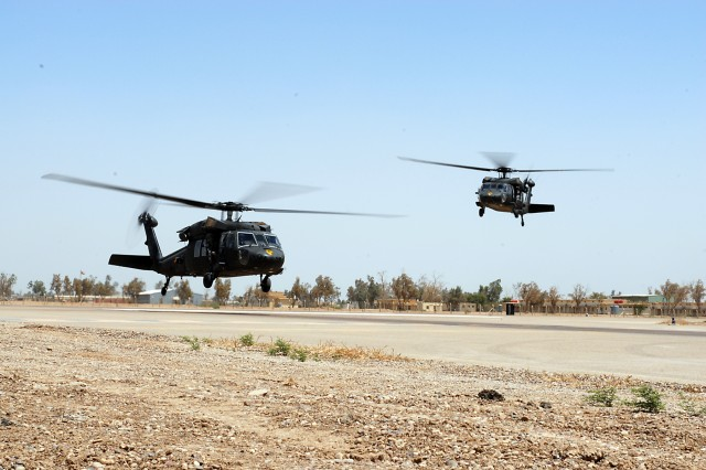 CAMP TAJI, Iraq-Two UH-60 Black Hawk helicopters from 3rd Assault Helicopter Battalion, 227th Aviation Regiment, 1st Air Cavalry Brigade, 1st Cavalry Division, Multi-National Division-Baghdad, arrive at Camp Taji, May 18, after making the journey from Camp Buehring, Kuwait, where they spent the past several weeks undergoing final preparations and environmental training for their deployment in support of Operation Iraqi Freedom.