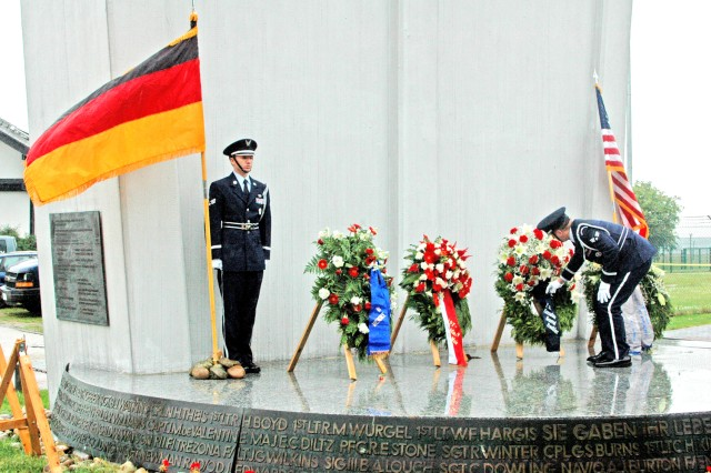 """Airmen from Ramstein Air Force Base present the wreaths during a ceremony marking the 60th Anniversary of the end of the Berlin Blockade at the former Rhein-Main Airbase Berlin Airlift Memorial."""""""