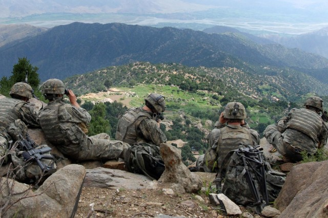 In this file photo, Soldiers provide overwatch for as other Soldiers searches a village below in the Chowkay Valley of the Kunar Province in Afghanistan.