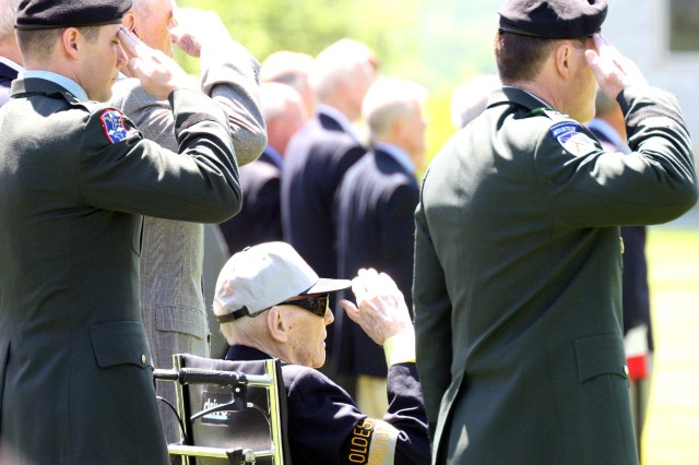 Retired Col. William H. Waugh Jr. (class of 1934), with Superintendent Lt. Gen. Buster Hagenbeck to his right, salutes the flag as it passes during the alumni review. Waugh was one of two members of the class of 1934 to be present at West Point Tuesday.