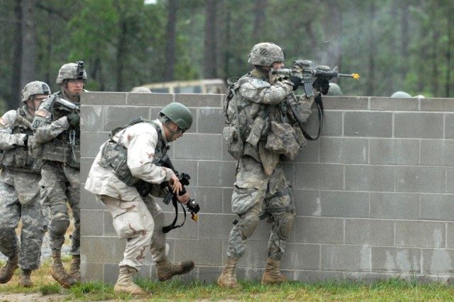 Soldiers assigned to  C Co, 2/69th Armor, 3rd HBCT, react to enemy fire during a training exercise at the Selby Military Operations Urban Terrain Site at Fort Benning, Ga., May 6. The exercise was part of Hammer Focus, the 3rd HBCT's largest field training exercise at Fort Benning.