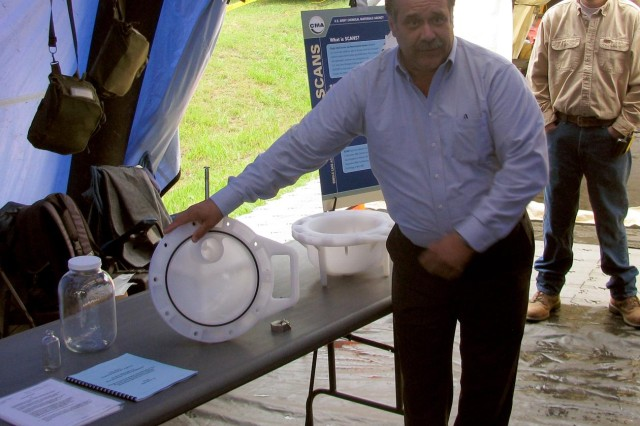Gary Hlavsa, non-stockpile chemical materiel program, demonstrates how the Chemical Agent Identification Sets found on Redstone will be destroyed.