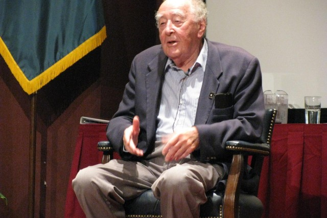 Charles Stein, a Jew who escaped Austria in the days leading up to the Holocaust, urges his audience to stand up for injustice and fight against apathy so that the rights of all people are protected. Stein spoke about his experience at Team Redstone's Days of Remembrance Commemoration Program on May 8.