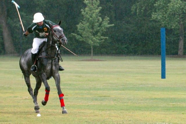 Julian Pettinato, a polo player with the Army polo team during the exhibition match held May 16 on Hedekin Field on Fort McPherson, smacks a ball downfield while warming up for the game.