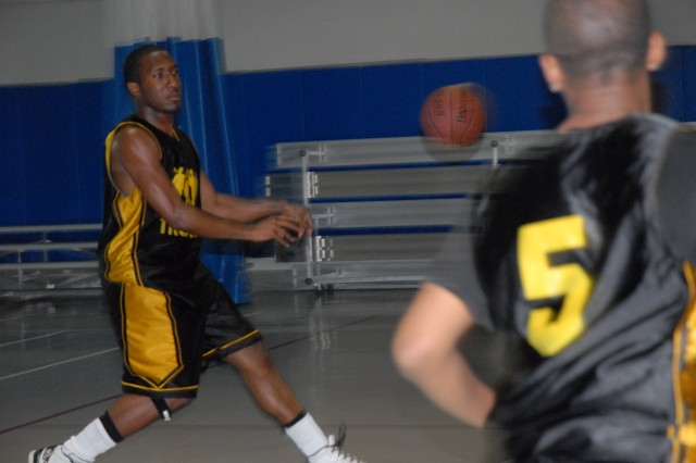 Troopz team member Preston Brown, 18, passes to a teammate during a practice. The team will play Fort Stewart Saturday.