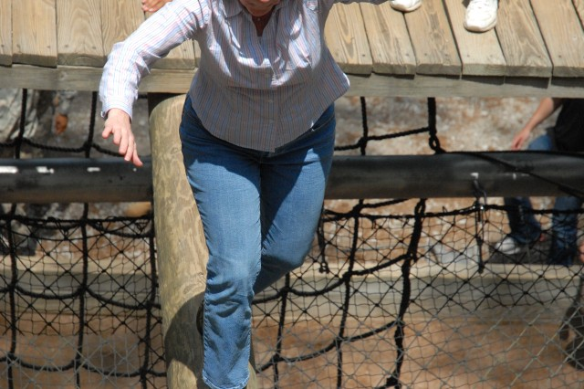 FORT JACKSON, S.C. -- Katherine Long, who works for U.S. Sen. Patrick Leahy, D-Vt., balances across one of the obstacles on the Confidence Course May 14. More than 40 congressional staffers visited Fort Jackson to gain insight on Basic Combat Training operations.   In addition to visiting the Confidence course, the staffers toured the 120th Adjutant General Battalion (Reception), ate lunch with Soldiers from their states at the 1st Battalion, 34th Infantry Regiment dining facility and observed training at several sites around post.