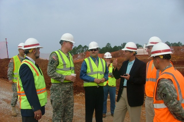 Pillsbury discusses the way ahead at the construction site with John Olshefski, G-4/7/9 BRAC strategic advisor; Mike Edwards, program manager; and several U.S. Army Corps of Engineers - Mobile District employees and contractors.