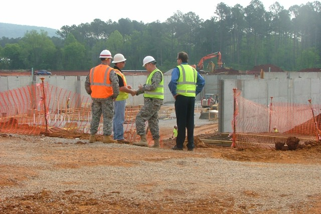 Pillsbury speaks with construction workers on the site of the new AMC and USASAC headquarters buildings.