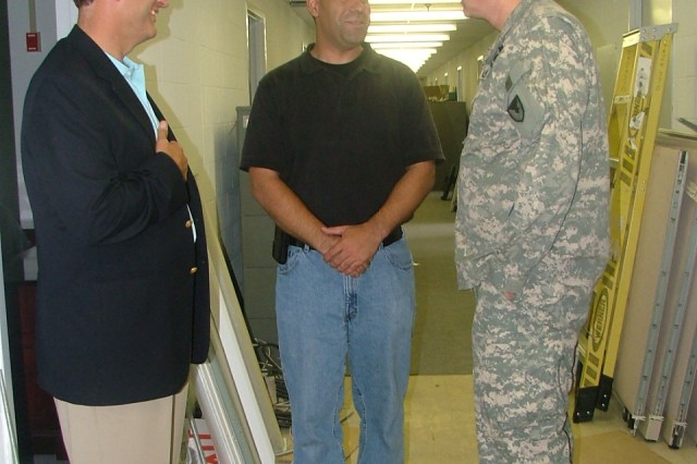 Pillsbury and Olshefski discuss IT in the transitional facilities with Redstone DOIM contractor, Chuck Pennington.