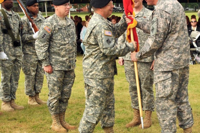 Brig. Gen. Todd T. Semonite (left) accepts the command flag from Lt. Gen. Robert L. VanAntwerp, chief of engineers, symbolizing the change of command for the U.S. Army Corps of Engineers, South Atlantic Division, in a ceremony held May 1 on Fort McPherson's Hedekin Field.  Semonite took command of the corps' southeast region, which is responsible for water resources and military construction in eight states.