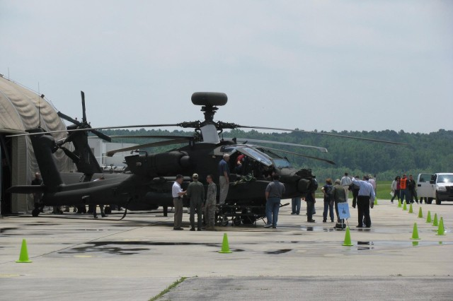 About a dozen helicopters and fixed wing aircraft sit on the tarmac in preparation for a close-up inspection by visitors during the Aviation Technical Test CenterAca,!a,,cs open house May 14. The Apache Long Bow was a favorite among the visitors.