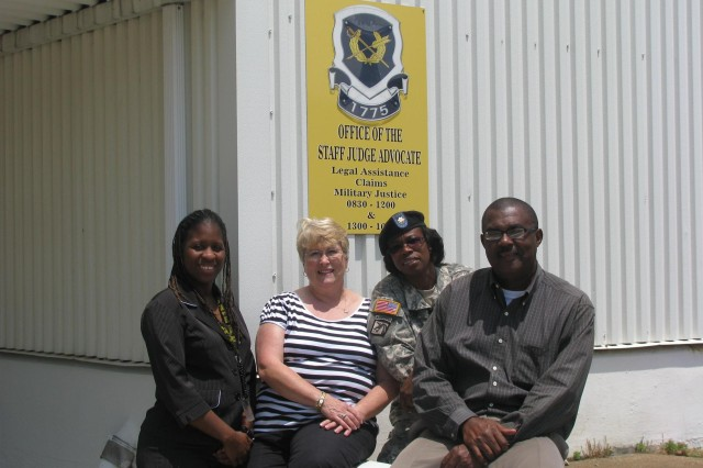 Members of the Claims Division include, from left, Erika McPherson, Suzanne Sammons, Maj. Kathleen Kelly and James Friday. Wyketa Watkins is not pictured.