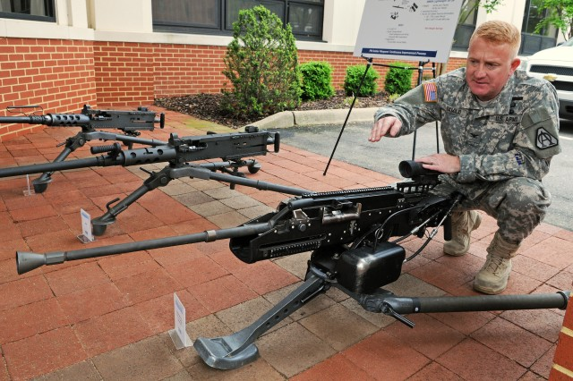 Col. Doug Tamilio, program manager for Soldier weapons and Soldier lethality and weight reduction, point out features of the Lightweight .50-Caliber Machine Gun. The lighter brother to the M-2 .50-caliber machine gun, it weighs half as much and has half as many parts along with 60 percent less recoil.