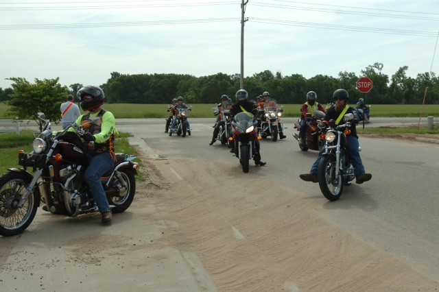 Soldiers and civilian employees of Fort Riley ride into the parking lot of the Kansas Auto Racing Museum in Chapman, Kan., during the 1st Infantry Division's inaugural motorcycle mentorship ride. In addition to stopping in Chapman, the riders also stopped at the Fort Riley Marina on the 70-mile trek. (U.S. Army photo by Sgt. Nathaniel Smith, 1st Inf. Div. Public Affairs)