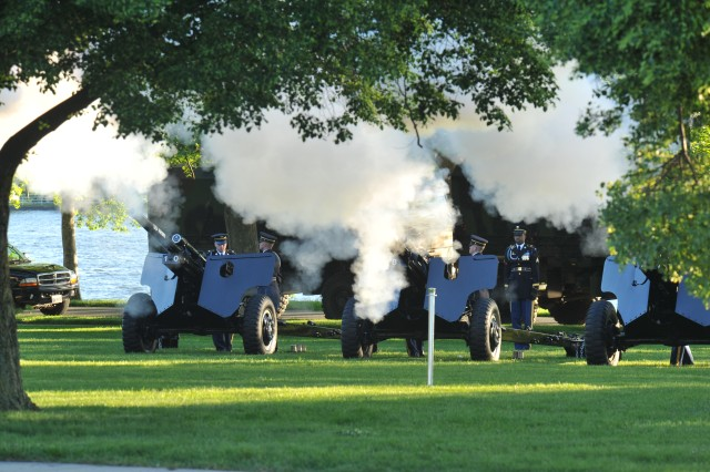 With the Washington Channel and the foliage of Fort McNair as a backdrop, The Presidential Salute Guns battery signals the start of another Twilight Tattoo.
