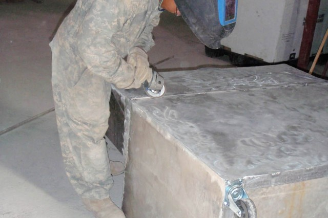 BAGHDAD-Honolulu, Hawaii native, Spc. Antonio Quebatay, of Troop D, 1st Squadron, 7th Squadron, 1st Brigade Combat Team, 1st Cavalry Division, grinds a sharp edge from a medical supply cart he constructed for use in the squadron aid station at Joint Security Station Istiqlaal, north of Baghdad..