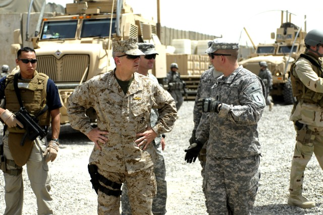 BAGHDAD – Lt. Gen. John Allen (center), deputy commander, U.S. Central Command, receives a briefing from 1st Sgt. Anton Hillig (right), senior enlisted member, Troop A, 5th Squadron, 4th Cavalry Regiment, 2nd Heavy Brigade Combat Team, 1st Infantry Division Multi-National Division –Baghdad, during a visit to Joint Security Station Ameriya, May 20, in the Mansour district of northwest Baghdad. Allen toured the site and was briefed on the closure plan for the JSS as the June 30th deadline for U.S. Soldiers to exit Iraqi cities nears.