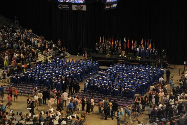 Manhattan High School seniors file in for their commencement ceremony at 2 p.m. on May 17 at Bramlage Coliseum.