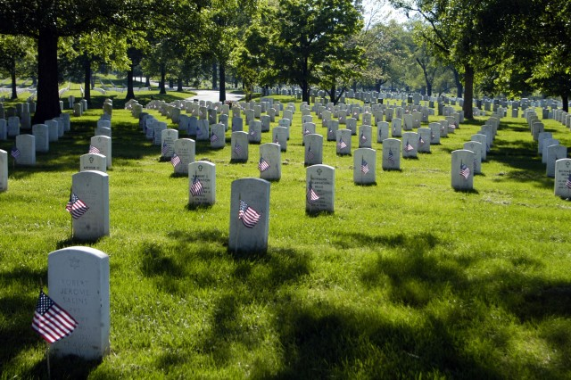 "Each marker in section 60 of Arlington National Cemetery, which holds veterans from Operation Enduring Freedom and Operation Iraqi Freedom, has a flag placed in front of it during the ""Flags In"" Memorial Day tradition, May 21."