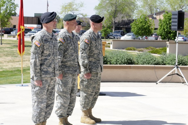 From Left to Right -- Outgoing Commander of the 100th Missile Defense Brigade (GMD) Col. Michael Yowell, stands next to Brig. Gen. Thomas Mills, Colorado National Guard Commander Ground Forces , during the change of command ceremony welcoming new 100th MD Bde. commander,(r) Col. Gregory Bowen.