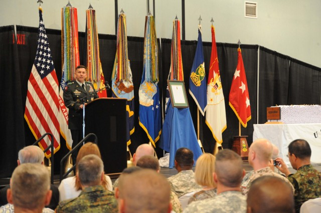 Lt. Gen. William B. Caldwell IV, commanding general Combined Arms Center and Fort Leavenworth, spoke to the more than 2,000 in attendance, May 21, at the graduation ceremony of Class 59 of the U.S. Army Sergeants Major Academy. Caldwell began his speech by first thanking the many family members in attendance for their support of their graduate during the nine months of instruction.