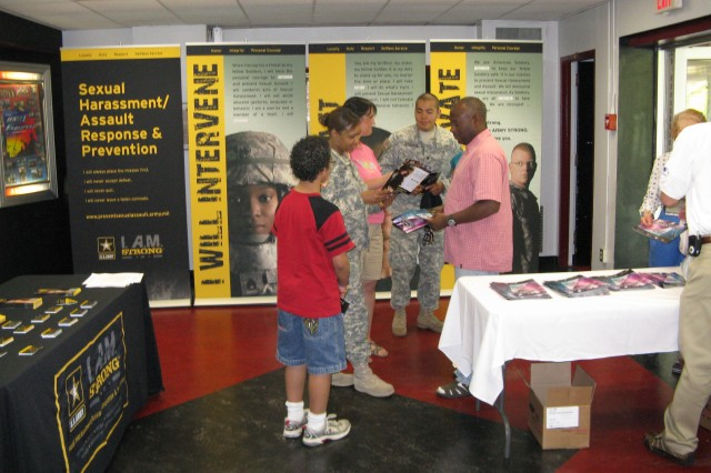 "Spc. Ismael Esquivel and Spc. Dana Singleton, Fort Belvoir BOSS volunteers, talked to families about the Army's I. A.M. Strong initiative at the Fort Belvoir Soldier Show, April 26, at the Wallace Theater. I. A.M. Strong stands for ""Intervene, Act and Motivate,"" and is the latest campaign in ending sexual harassment and assault in the Army."