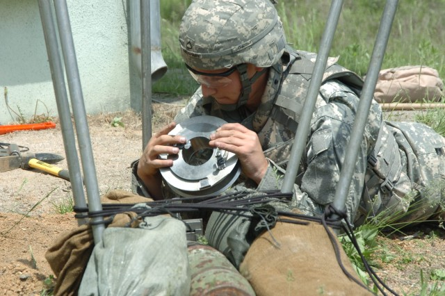 Pfc. Jordan Krogmann from the 718th Ordnance Company (Explosive Ordnance Disposal) works through a scenario during the 2009 EOD of the Year competition at Rodriguez Live Fire Complex May 18.
