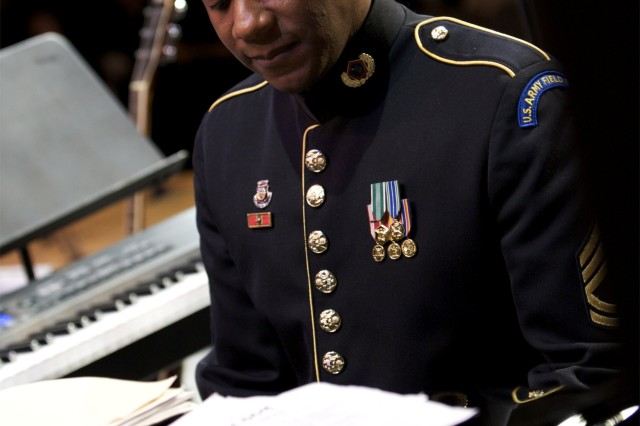 Sgt. 1st Class Tim Young plays piano for a full house in Emmaus, Penn.