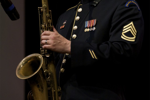 Sgt. 1st Class Pat Shook gets the crowd in Emmaus, Penn. wows the audience on the tenor sax.