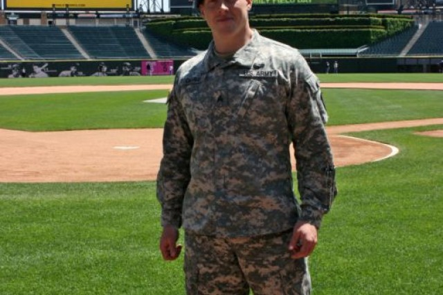 """U.S. Army Soldier of the Year, Sergeant David Obray, 492nd Engineer Company, 416th Theater Engineer Command, enjoys the Chicago White Sox """"Family Field Day"""" experience with families of deployed Soldiers from the 33rd Brigade Infantry Combat Team, Illinois Army National Guard. Major General Richard Formica, Commander, Combined Security Transition Command-Afghanistan and Brigadier General Steve Huber, Joint Task Force Phoenix Commander, answered questions from family members that attended a Webcast with senior leadership in Kabul Afghanistan. The Webcast, Sponsored by 'We Do Care,' and hosted by the 'U.S. Cellular Corporation,' allowed the families to interact with community leaders and address any concerns. After the broadcast, the family members, along with honored guest, Sgt. Obray, were able to enjoy the entire on-field experience."""