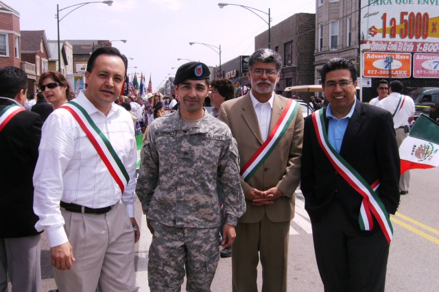 "Sergeant Oscar Gutierrez, 5th/94th Battalion, USAR, interacts with the local Aldermen of Chicago's Pilsen neighborhood after the 26th Annual, ""Cinco De Mayo"" Parade on Sunday, 03 May, 2009, where they all were Co-Grand Marshalls.  Gutierrez was invited to participate in the parade by the Casa Puebla Chamber of Commerce, President, Mr. Hector Escobar."