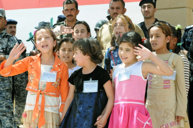 CONTINGENCY OPERATING BASE SPEICHER, TIKRIT, Iraq- A group of girls from the Tikrit Orphanage sung songs of ending war, establishing friendship and peace during the first district validation ceremony for Iraqi Policemen at the Tikrit District Headquarters, May 19. Tikrit is the first district in Salah ad-Din province to become validated to operate independently.