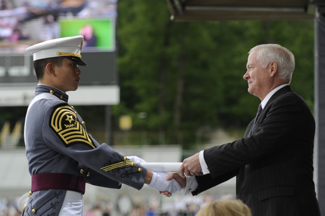 Defense Secretary Robert M. Gates hands a diploma and congratulates an honor graduate at the U.S. Military Academy at West Point, N.Y., May 23, 2009.