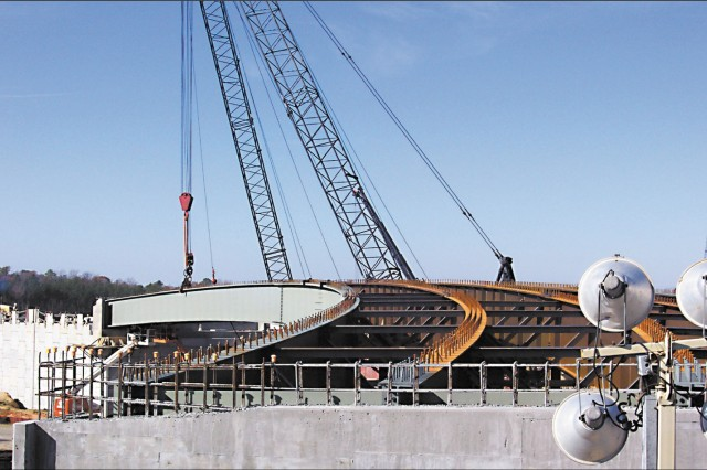 Cranes lift the final steel into place
