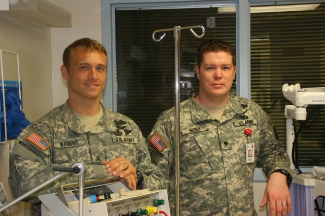 (From left) Staff Sgt Gabriel Wright and Spc. Brenden Beely of the Army Institute of Surgical Research, Brooke Army Medical Center, won the 2009 Hot Technologies Contest by submitting an invention called a Medical Tube Securing Device, a piece of equipment for securing medical tubes and catheters intubated within a patient that will prevent damage to the incisors by locating separate bite blocks on the molars.