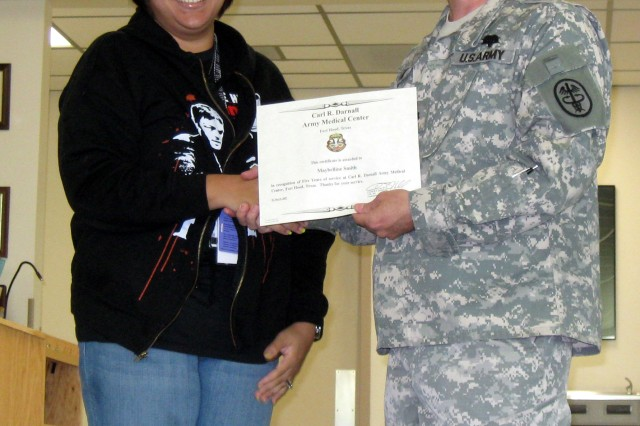 Maybelline Smith, Quality Assurance Officer with Robertson Blood Center at Fort Hood, is presented a certificate of appreciation for five years of service to the center by Lieutenant Colonel Ronny Fryar.  Prior to her service as a Department of the Army Civilian she served as an enlisted Medical Technologist at Fort Polk, Louisiana.