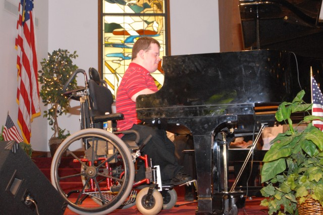 Patrick Henry Hughes played the piano and sang for the crowd at Stithton Baptist Church during the Hooray for Heroes ceremony.